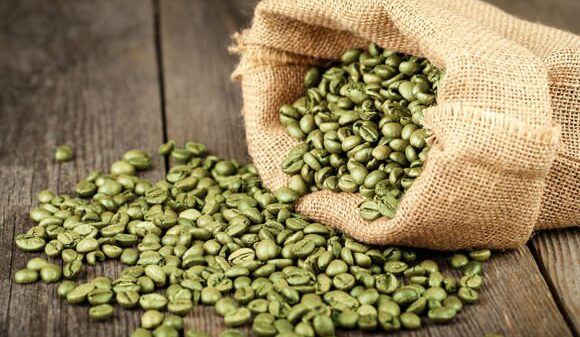 green coffee beans in a bag